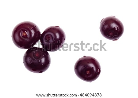 Five juicy fragrant cherries with water drops on white background isolated top view.