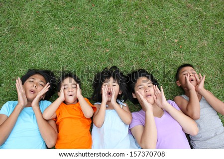 Five kids having good time in the park.  - stock photo