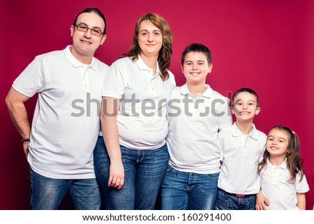 Five Member Family Smiling Isolated over a Red Background - stock photo