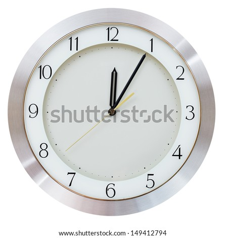 Five minutes after midnight (after twelve hours) on the dial round wall clock - stock photo