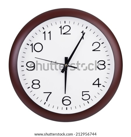 Five minutes past six on a round dial - stock photo