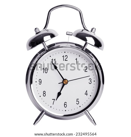 Five minutes to seven on a round metal alarm clock