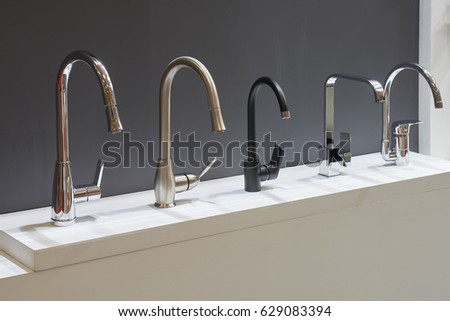 Five mixers for bathroom in the store