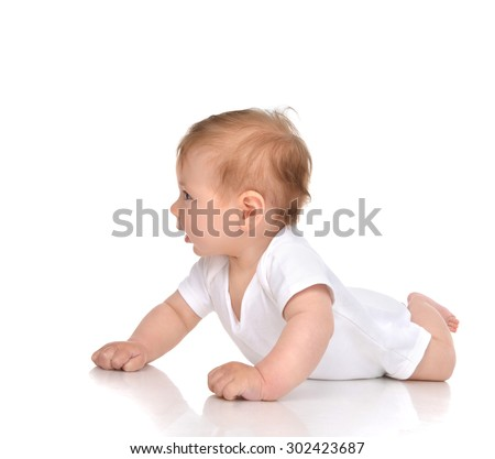 Five month Infant child baby girl lying happy looking isolated on a white background