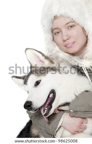 Five month old malamute puppy with a girl. - stock photo