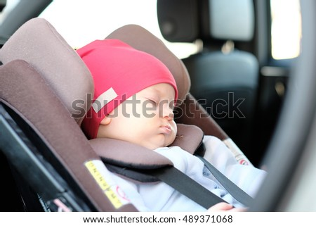 Five months old baby sleeping in car seat