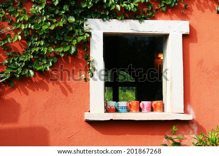 Five mugs over white window