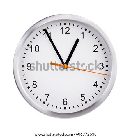 Five o'clock on a round clock face - stock photo