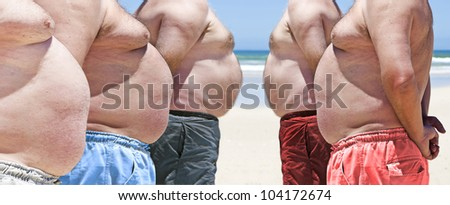 Five obese fat men on the beach