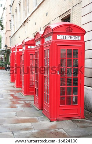 five old red phone boxes in London