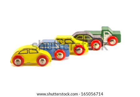 five old wooden colorful retro toy cars isolated on white background - stock photo