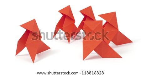 Five origami birds on white background. Concept of mobbing/bullying - stock photo