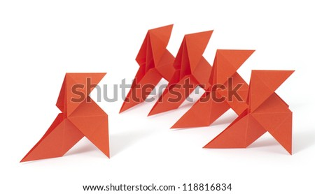 Five origami birds on white background. Concept of mobbing / bullying - stock photo