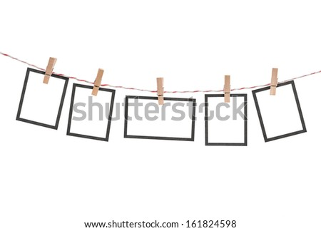 five photos hanging isolated on white - stock photo