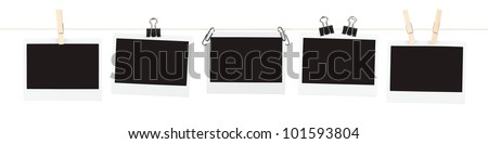 Five pieces of blank film held on a string with various clips isolated on white. - stock photo
