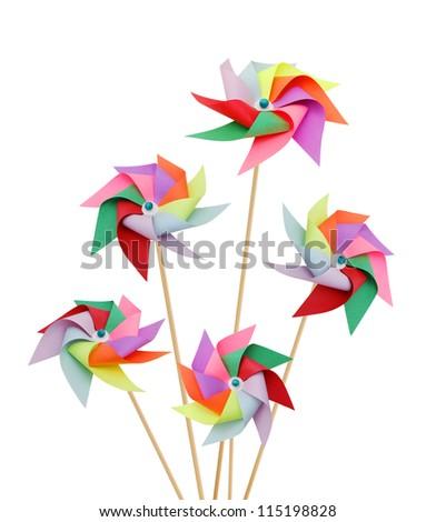 Five pinwheels on white - stock photo