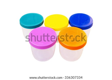 five plastic container which have color lid on white background - stock photo
