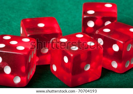 Five red casino dices on green background - stock photo