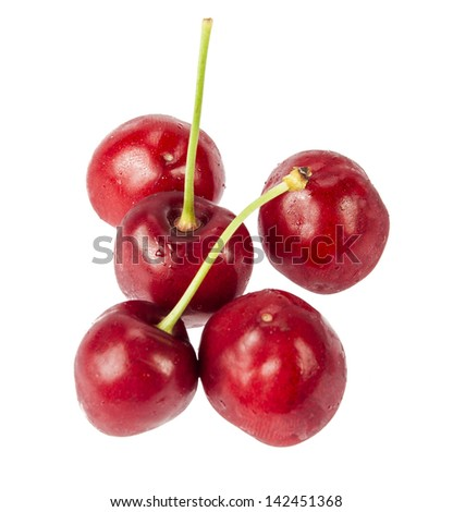 Five red cherries isolated on white background