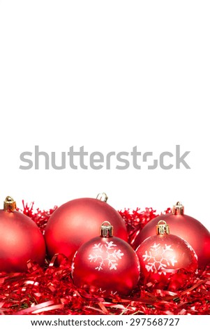 five red Xmas balls and tinsel isolated on white background
