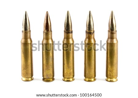Five rifle bullets over white - stock photo