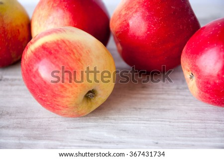 Five ripe apples on a retro background - stock photo