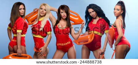 Five sexy lifeguards women  - stock photo