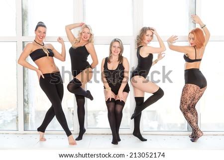 five sexy woman posing on window - stock photo