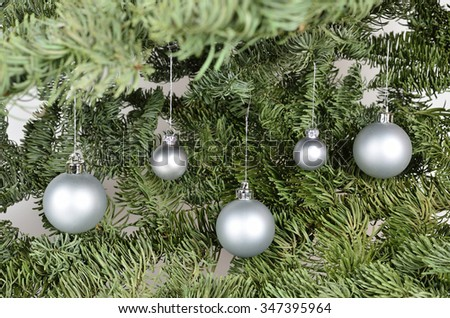 Five silver christmas balls on a green background  /  Silver balls - stock photo