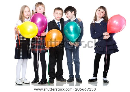 Five smiling schoolchild standing with colorful baloons, isolated on white - stock photo