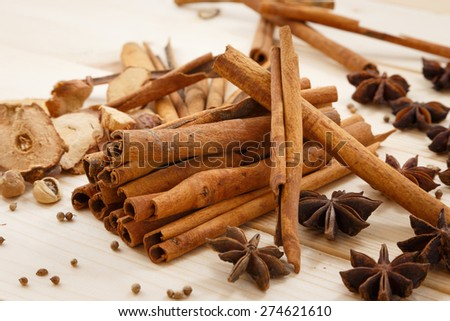 Five spices on the wood table - stock photo