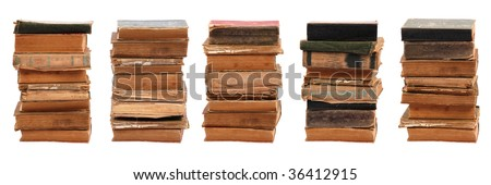 Five stacked old books of different shape and color. Isolated on white background. - stock photo