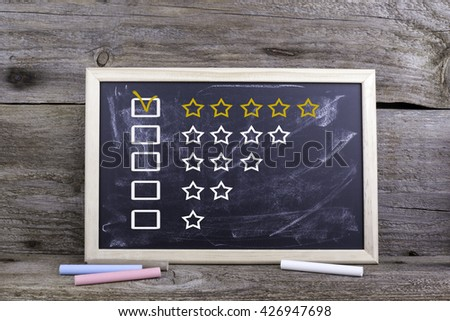 Five star rating concept on blackboard - stock photo