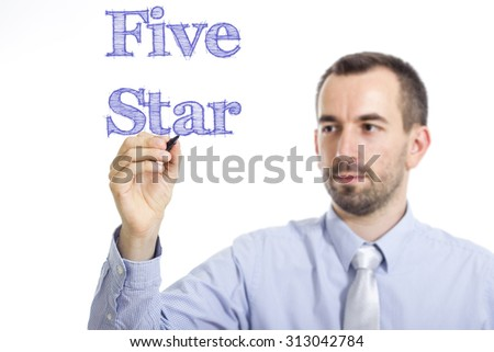 Five Star - Young businessman writing blue text on transparent surface - stock photo