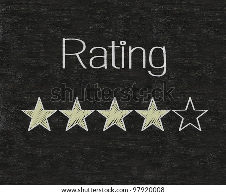 Five stars ratings web yellow written on blackboard background - stock photo