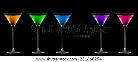 Five stemmed cocktail glasses full of different colored fruity liquors, panorama, with copy space on black. Template design with sample text - stock photo