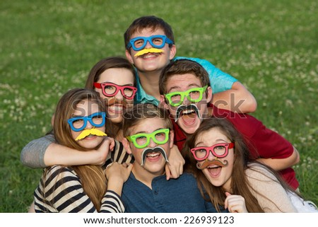 Five teenage male and females in mustache disguise