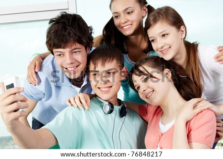 Five teenagers taking photo of themselves - stock photo