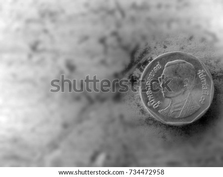 Five Thai Baht coin on the gray background