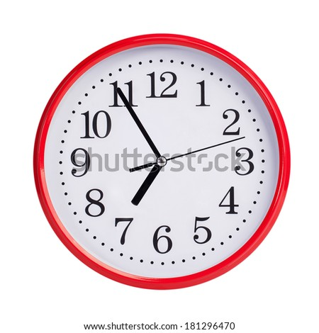 Five to seven on a red round clock face - stock photo