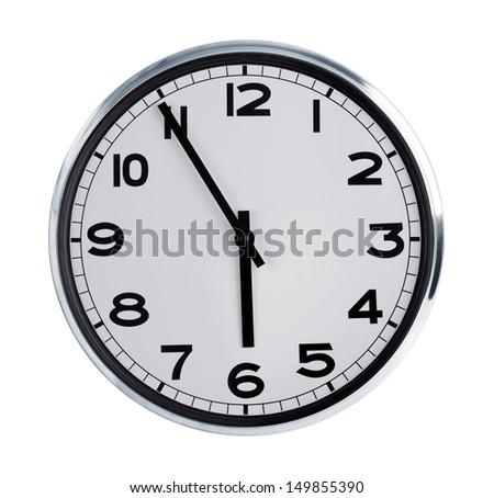 Five to six on the large round wall clock - stock photo