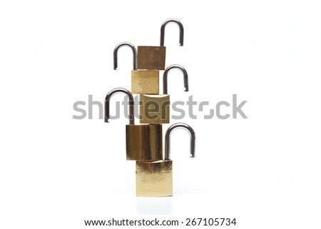 five unlock security locks piling up vertically representing vulnerability and data encryption in computer  - stock photo