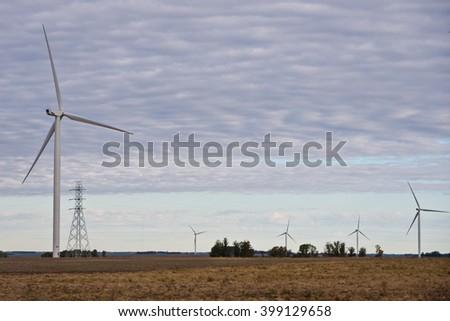 five windmills in rural uruaguay, south america - stock photo