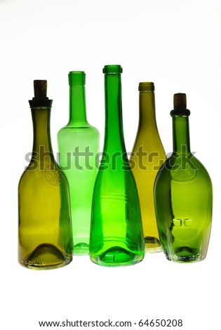 Five wine bottles isolated over white background