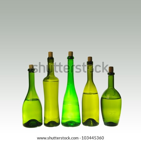 Five wine bottles  on gray  background.