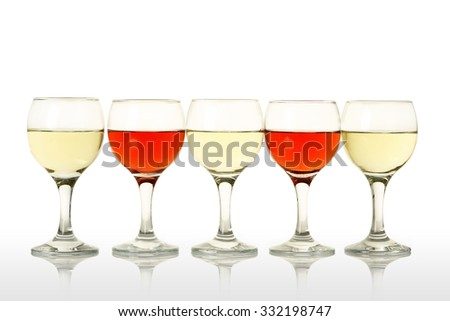 five wine glasses with pink and white wine