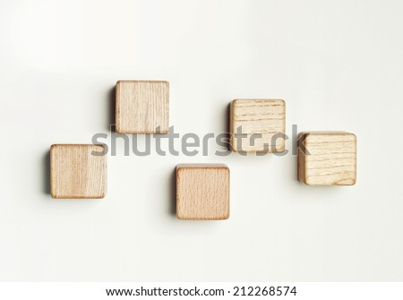 Five wood blocks in the white background. - stock photo