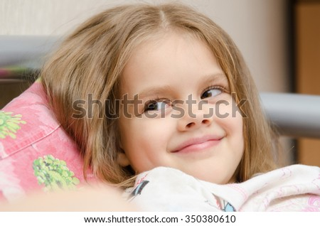 Five-year girl cute smile looking to the left - stock photo