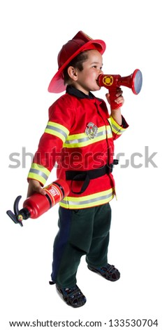 Five year old boy in a suit firefighter says in speaker - stock photo