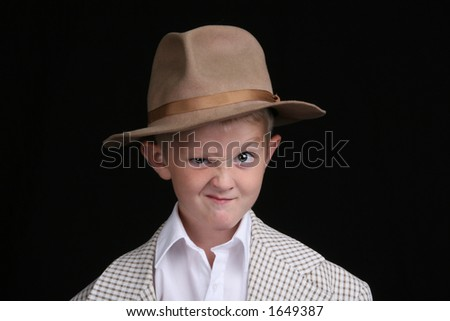 five year old boy playing dress-up makes a cartoon face - stock photo
